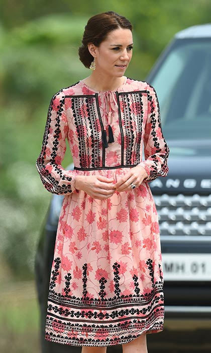 Showing us all how to do high street, Kate modelled a stunning pink Topshop dress with intricate black embroidering, and added a touch of sparkle to the look with her bargain $14 earrings from Accessorize.