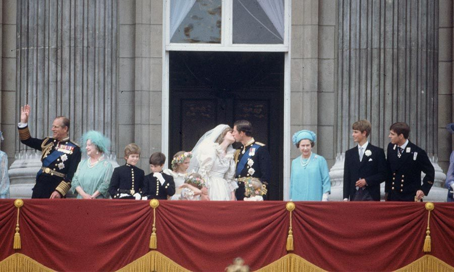 At ten minutes past one, Charles and Diana emerged on the balcony of Buckingham Palace with their wedding party, along with the Queen and the Queen Mother, where they shared a public kiss. 