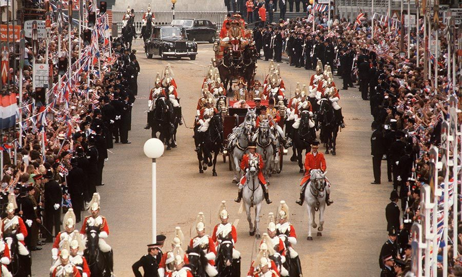 Diana and Charles were escorted to the palace by the Household Cavalry as they waved to the huge crowd of well-wishers. 