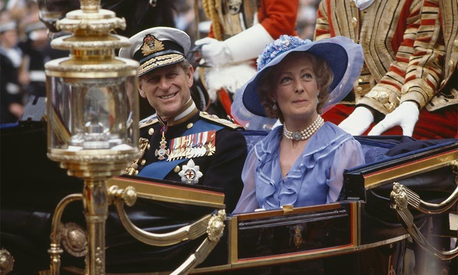 The father of the groom, Prince Philip, and the mother of the bride, Frances Shand Kydd, rode together in an open carriage on their children's wedding day.