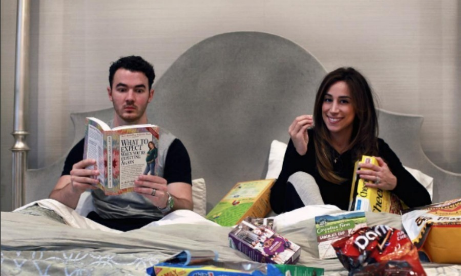 Kevin and Danielle Jonas had a lot of literature and snacks around for their second child's birth announcement. Valentina was born in October 2016.