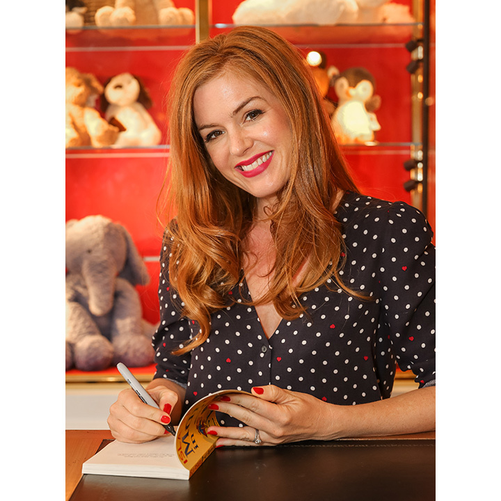 Isla Fisher was all smiles as she signed copies of her new book <i>Marge in Charge</i> at Harrods in London. 