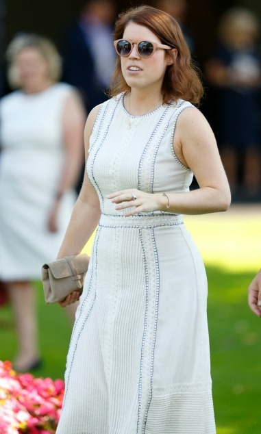 Princess Eugenie enjoyed a stylish day out at the races in a white sundress and statement shades.<br>