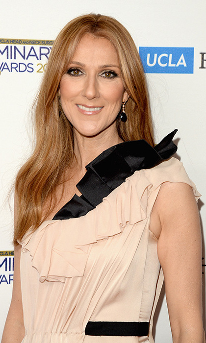 Celine Dion is considering getting a tattoo tribute to her late husband .