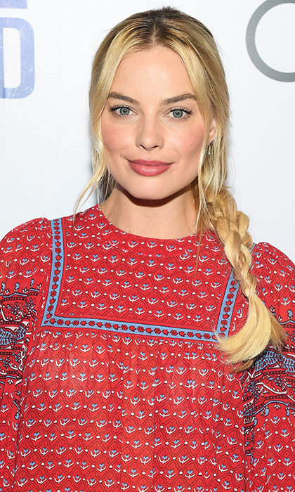 Mastering the braid trend with a boho chic side plait, teamed with shimmering pink lipstick and a hint of eyeliner. 