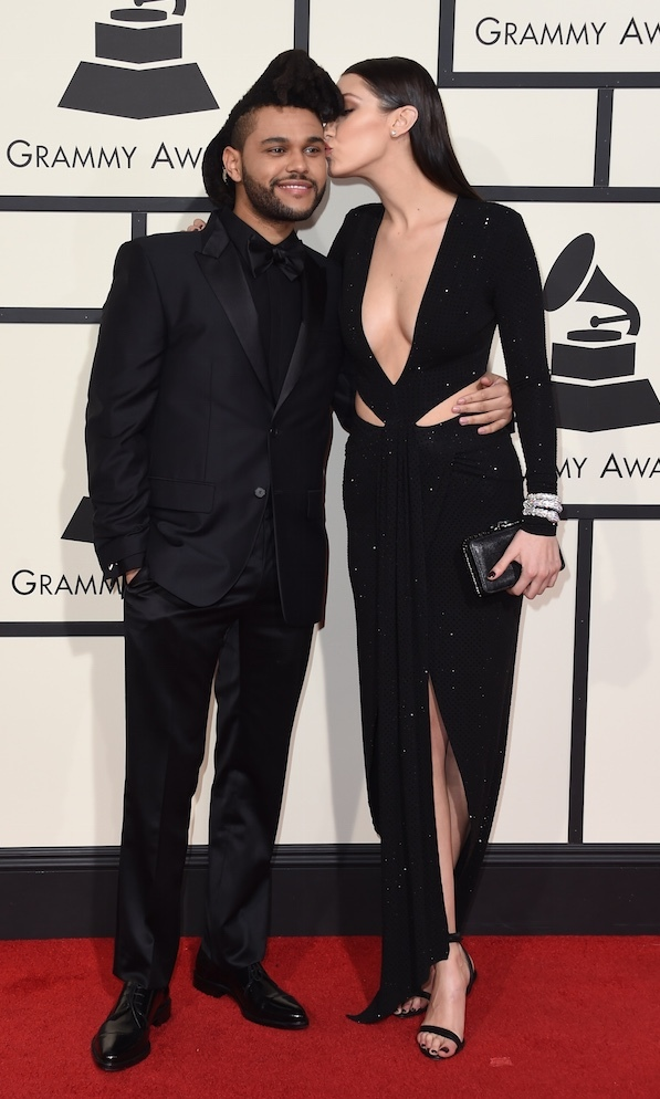 Bella supported Abel at the 2016 GRAMMYs, where he picked up two awards.
