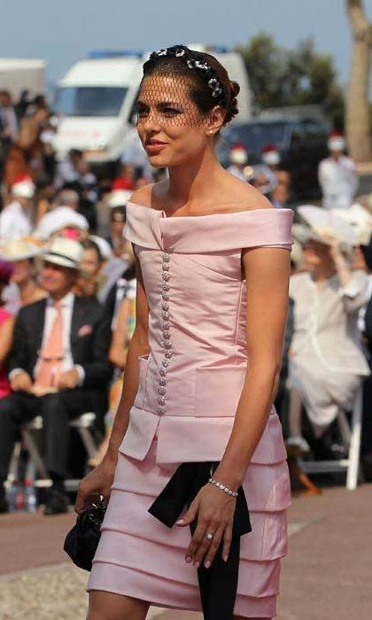 Wearing a pale pink off-the-shoulder dress by Chanel.