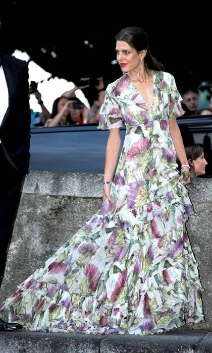 Elegant in a floor-sweeping floral gown.