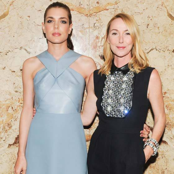 Rocking a pale blue leather dress as she poses up with Frida Giannini at a Gucci event.