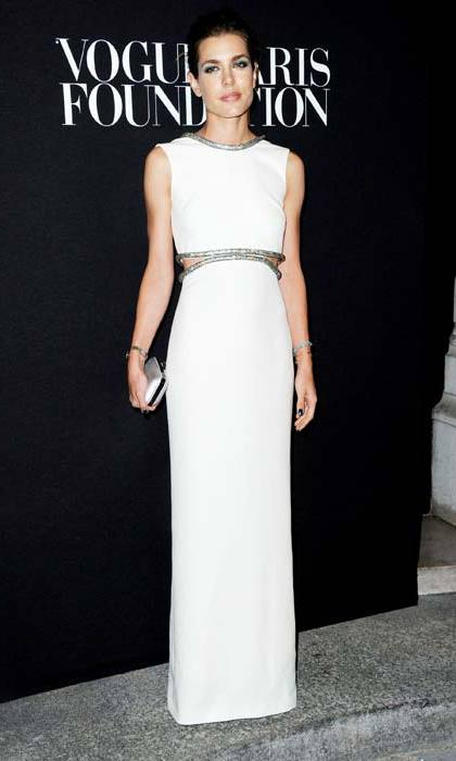 Showing a hint of midriff in this white cut-out gown.
