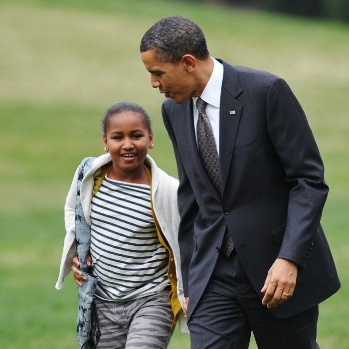 2011: Sasha ran to greet her father on the South Lawn when he touched down at the White House after a five-day trip to Latin America.
