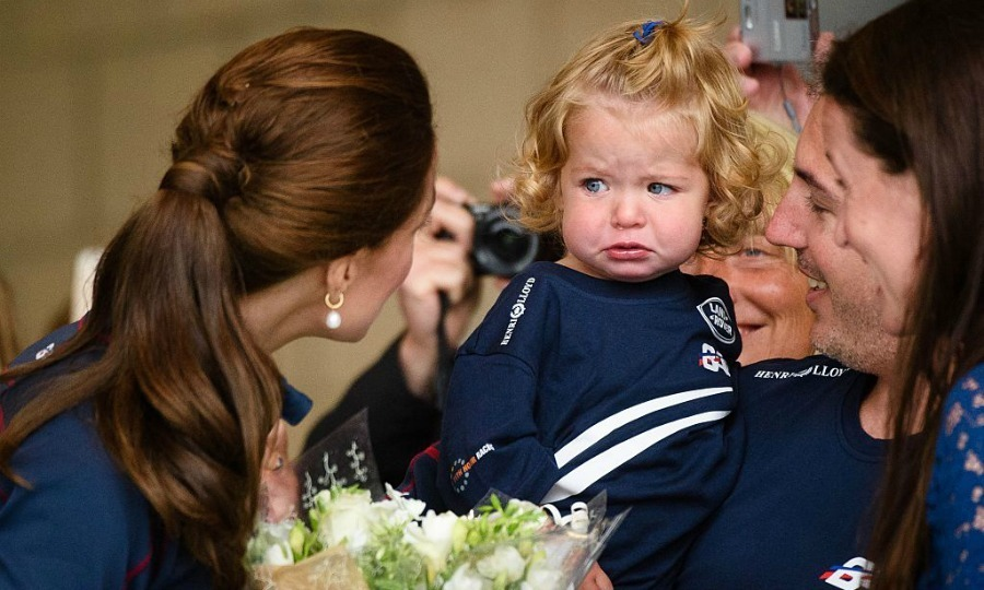 Why so sad? One adorable little tot wasn't susceptible to Kate's charm at the British Land Rover BAR America's cup team center in 2015. 