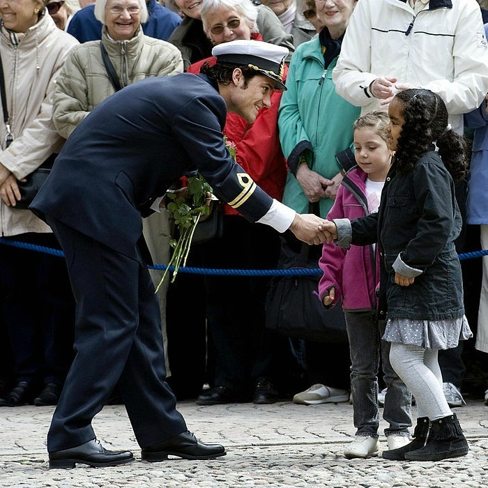 Pleased to make his acquaintance! Sweden's Prince Carl Philip greeted two young girls during his 30th birthday celebrations in 2009.