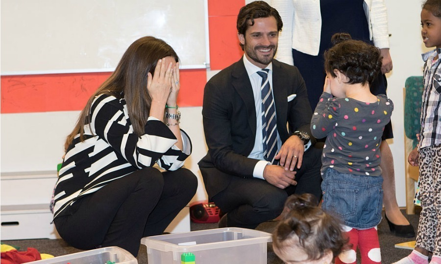 Peek-a-Boo! Princess Sofia of Sweden played with a new friend while visiting a consultant unit for refugees during a trip to Dalarna with husband Prince Carl Philip.