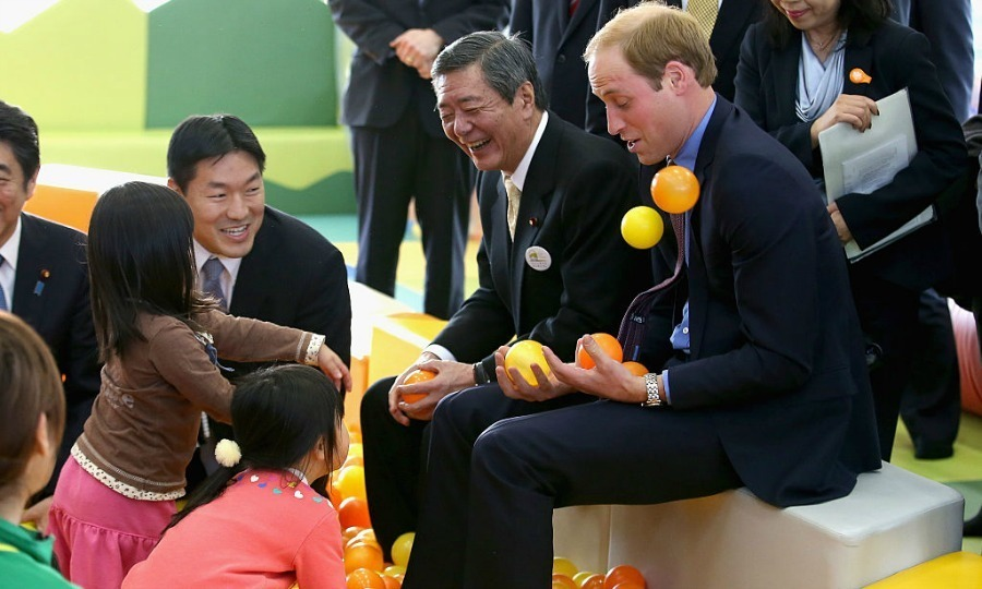 A group of children had a ball — literally — with Prince William. Young girls got sporty with the Duke during his visit to Smile Kid's Park in Koriyama, Japan.