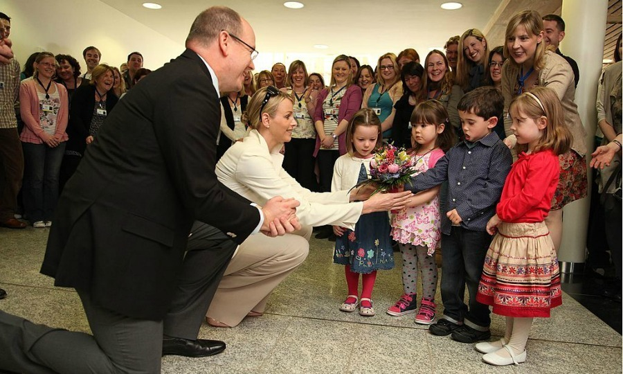 Flowers for you! Prince Albert and his then-fiancée Princess Charlene were presented with a floral arrangement by children from the Marine Institute creche.