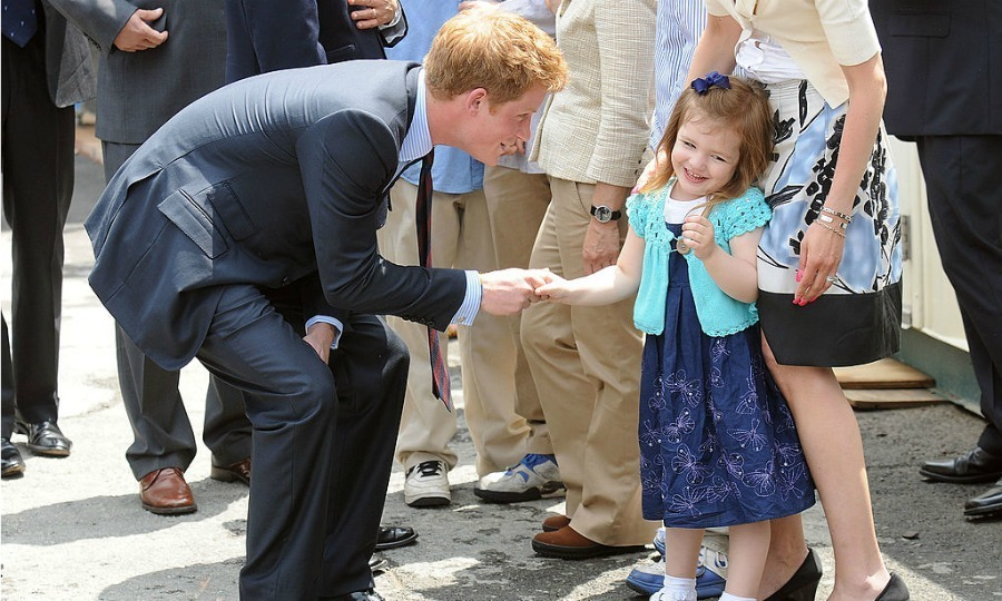An adorably dressed young girl couldn't help but swoon upon meeting Prince Harry at the World Trade Center site in 2009.