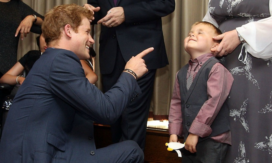 Got you! Prince Harry had some fun with a boy named Alex Logan at the 2012 WellChild Awards in London.