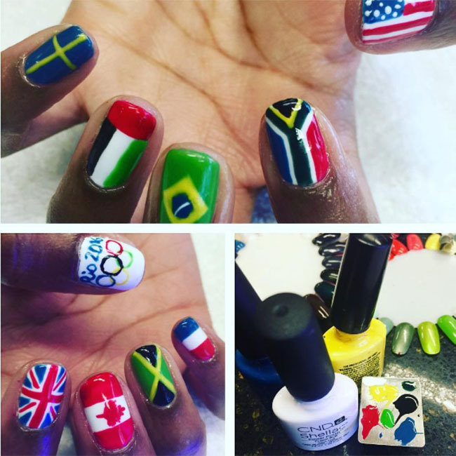 "Take note from <a href=""https://www.instagram.com/kameronlnailsmt/"" target=""_blank"">@kameronlnailsmt</a> and try painting a different country's flag on each nail, and paint one nail with an Olympic Rings pattern for an eye-catching style. 