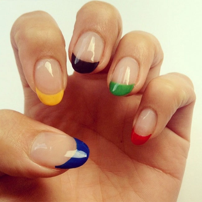 "If you want to try Olympic-themed nail art but don't have much time, try simply painting the tips of your nails the same colours as the Olympic rings like <a href=""https://www.instagram.com/nailsbymh/"" target=""_blank"">@nailsbymh</a>.