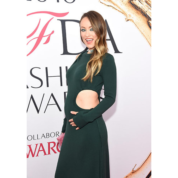 The mom-to-be showed off her playful side in a gorgeous green Rosie Assoulin gown featuring creative cutouts at the 2016 CFDAs in New York.  