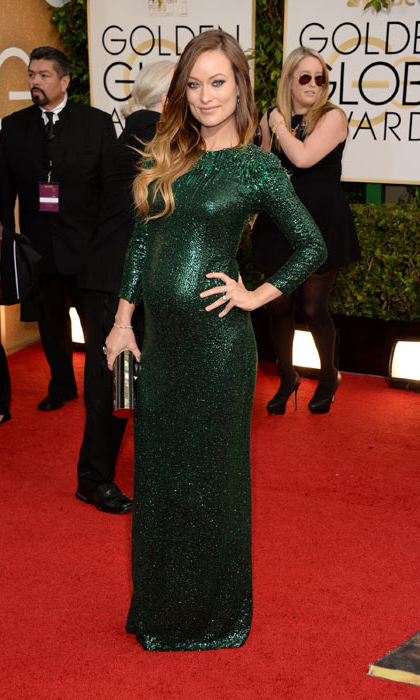 Red-carpet maternity style doesn't get much better than the skintight emerald green Gucci gown Olivia wore to the 2014 Academy Awards. 