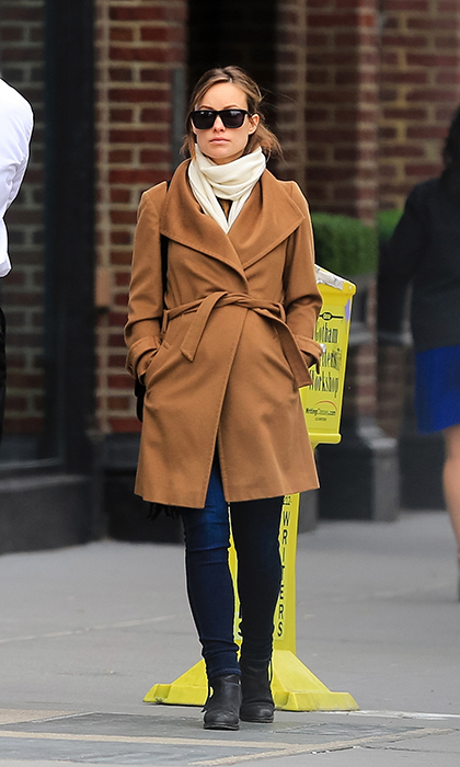 The actress bundled up her bump in a tan coat and skinny jeans for a stroll through the streets of New York in 2014. 