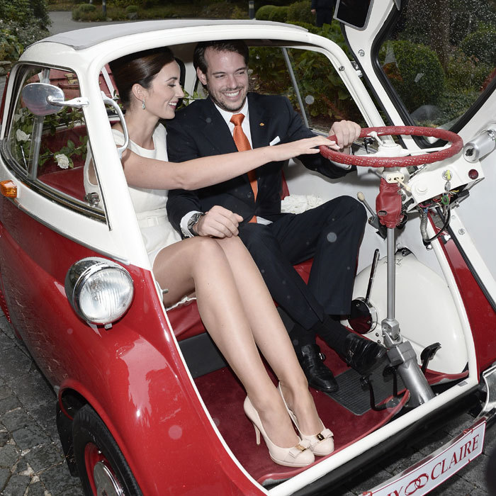 <p>Now legally husband and wife, the royal duo prepare to drive off into married life in their cute 'just wed' car.