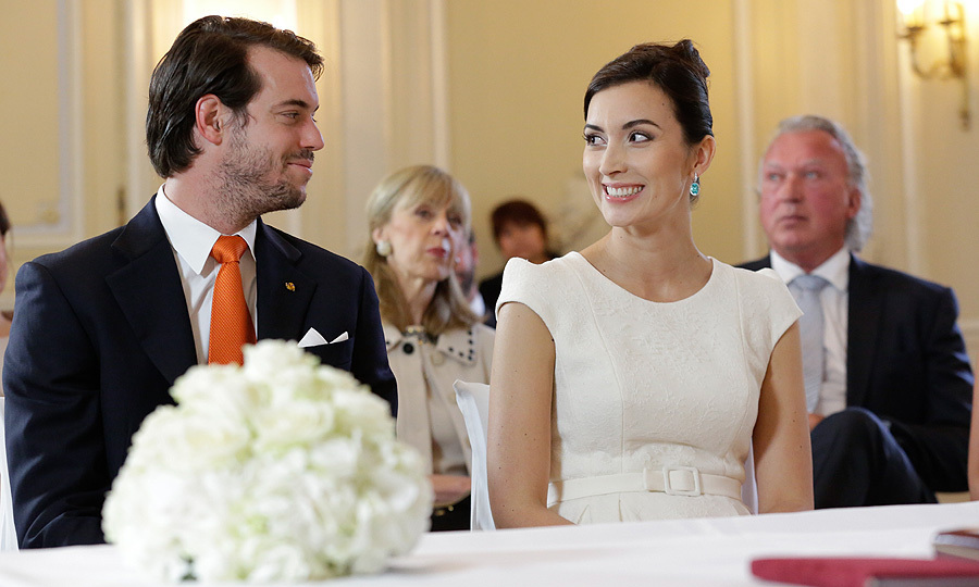 <p>The nearlyweds share the look of love during their civil ceremoy.