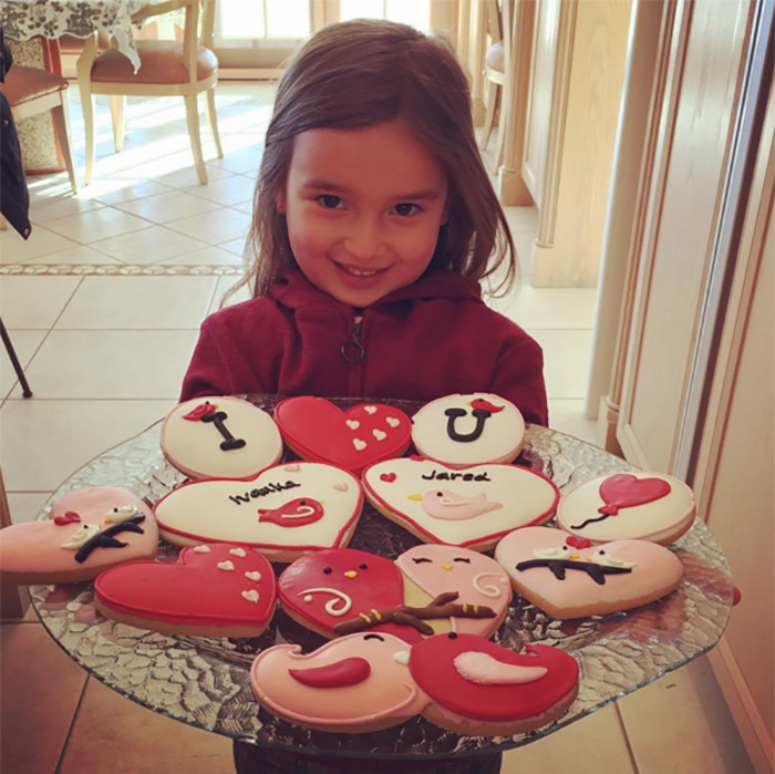 Arabella made sweet cookies for her mommy and daddy to celebrate Valentine's Day.