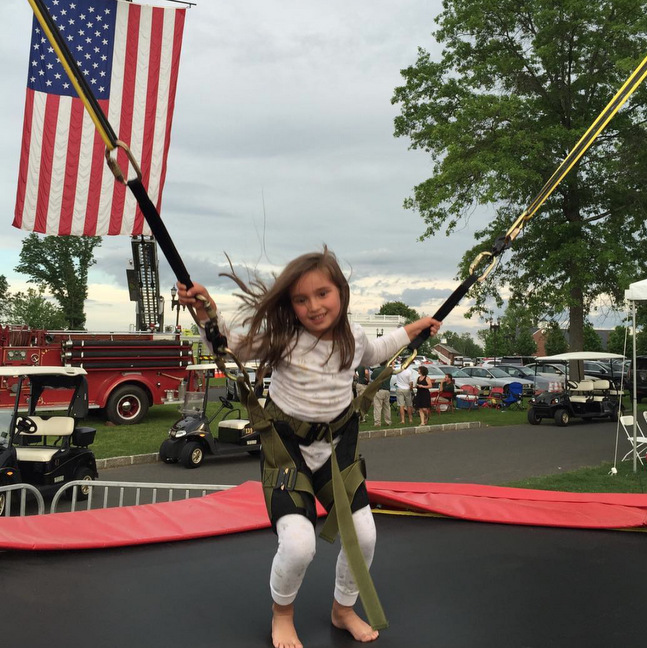 Arabella enjoyed some summer fun, jumping around during Memorial Day weekend.