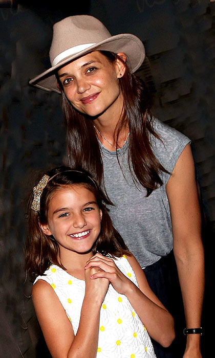 Katie Holmes and daughter Suri were all smiles after catching a production of <i>Finding Neverland</i> at the Lunt Fontanne Theatre on Broadway. The beautiful 10-year-old is looking more and more like her famous father Tom Cruise.  