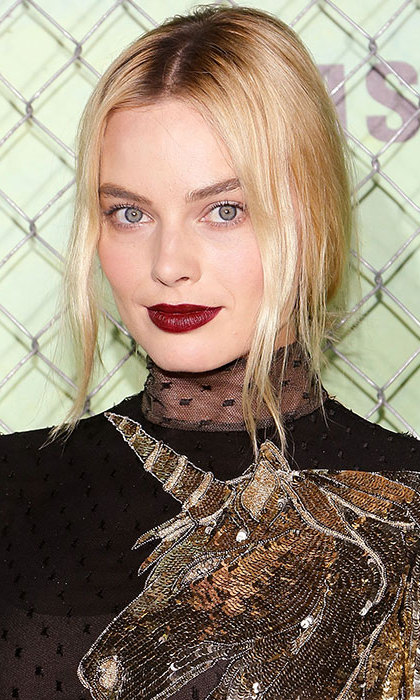 Margot Robbie showed off her vampy side at the Suicide Squad premiere with an eye-catching dark berry-hued lipstick, teamed with a low, messy bun. 