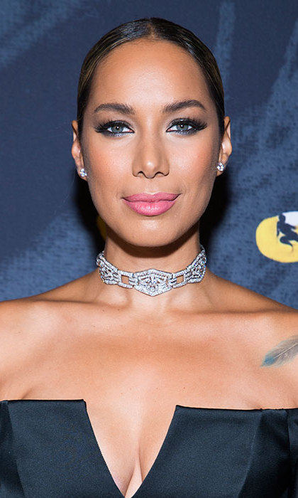 Leona Lewis turned heads at the after party for the opening night of <em>Cats</em>, looking every inch a beauty icon with her hair slicked back into a wet look bun, paired with one of the season's biggest make-up trends, pink lipstick.