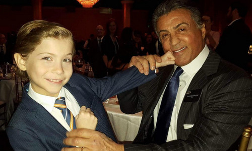 "Jacob knows how to knock out the competition with his adorableness. The Critics' Choice winner hung out with ""champ"" Sylvester Stallone at the 2016 Oscars nominees lunch in Hollywood. 