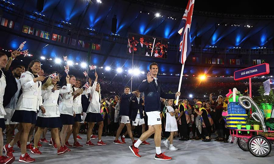 Andy Murray waved to the cameras as he led Team GB while carrying the Union Jack flag.<br> 