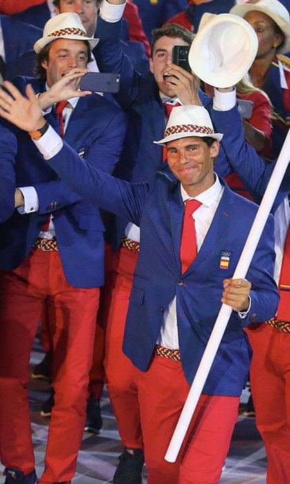Star tennis player Rafael Nadal led the Spanish team as the flag bearer.<br> 