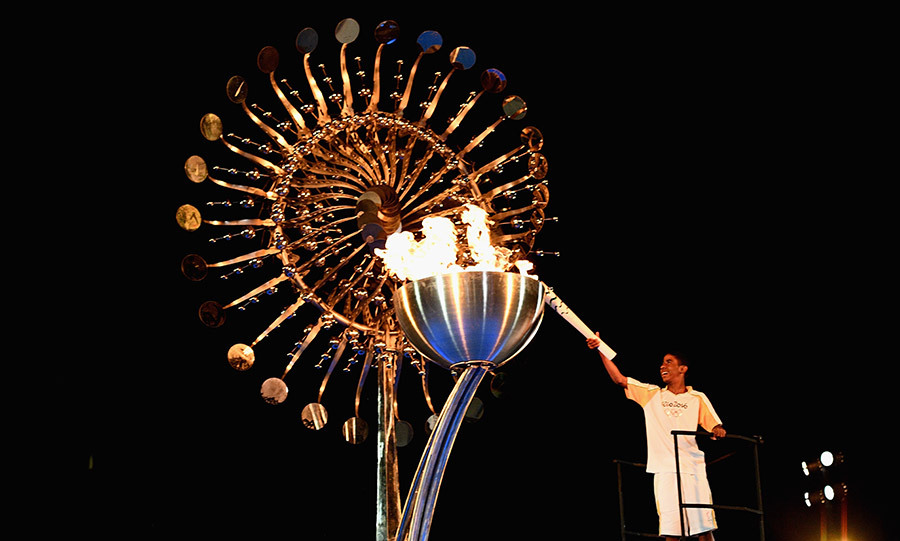 The Olympic cauldron, modelled to replicate the sun, was lit in the stadium.<br> 