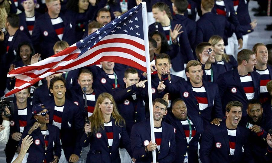 Champion swimmer Michael Phelps carried the US flag in the Athletes Parade.<br> 