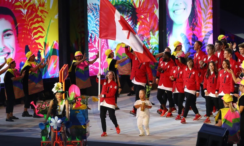 Olympic gold-medal gymnast Rosie MacLennan carried the flag for an excited Team Canada.<br>