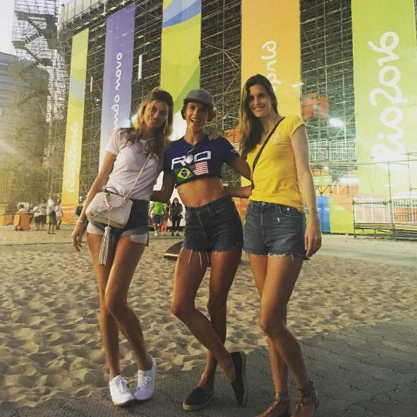 <p>Alessandra has also been lucky enough to watch some of the Olympics over the weekend. Proudly representing her country in a Rio t-shirt and denim cut offs, the model joined friends to watch the Beach Volleyball game.