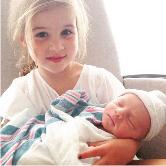 "Tiffani Thiessen shared the news of her growing family with the message, ""Yesterday Harper got a little brother! We are so excited to introduce Holt Fisher Smith. Our perfect sweet little man. #weareblessed #familyoffour.""