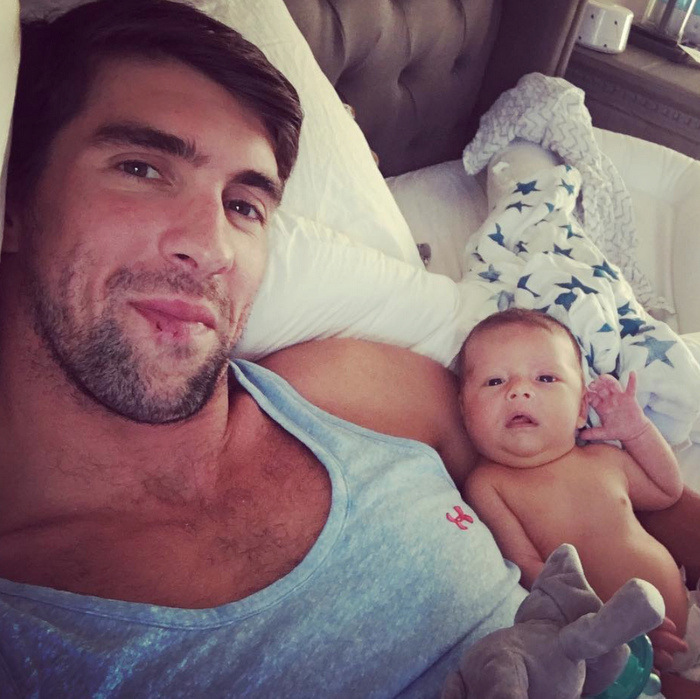 "Like father, like son. Olympic swimmer Michael Phelps shared a laid-back photo of himself and his son Boomer Robert Phelps, whom he welcomed on May 5, 2016 with his fiancée Nicole Johnson. The proud first-time dad had announced his son's arrival, writing, ""Welcome Boomer Robert Phelps into the world!!! Born 5-5-2016 at 7:21 pm !!! Healthy and happy!!! Best feeling I have ever felt in my life!!!""