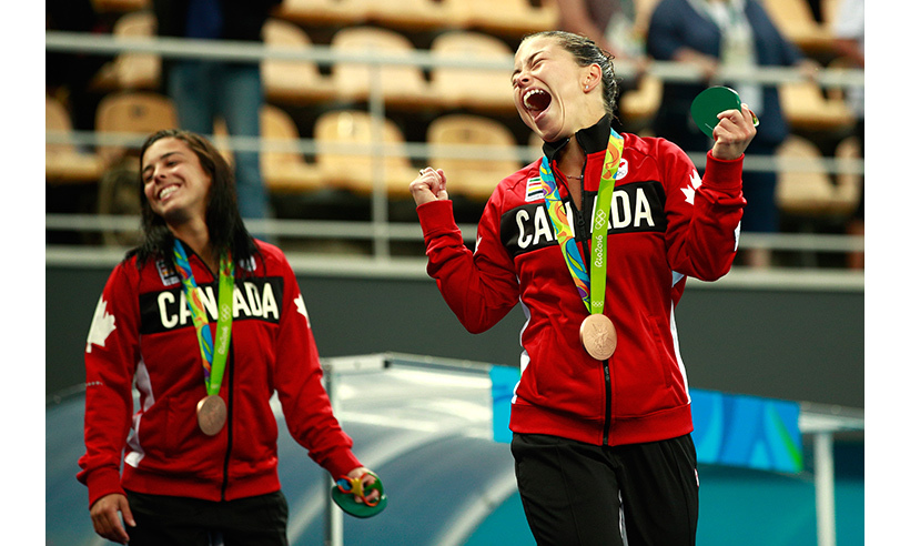 Meaghan Benfeito and Roseline Filion celebrate their bronze medal finish in women's synchronized 10m platform diving. It was a case of déjà-vu for the duo, who won the same medal at the 2012 games in London. 