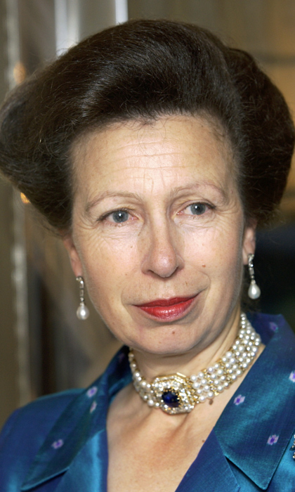 Diana wasn't the only British royal to embrace the choker trend. Here, Princess Anne wears the Empress Maria Feodorovna choker. Queen Mary purchased the necklace and it has since been handed down through generations of royal women. It features four strands of pearls with 20 diamond-encrusted vertical bars segmented throughout. 