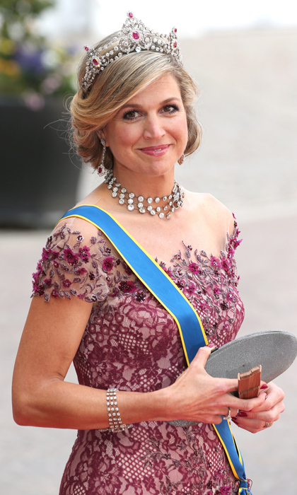 Here, Queen Maxima of the Netherlands matches her heirloom tiara with a choker comprised of floating diamonds. <p>Photo: © Getty Images</p>
