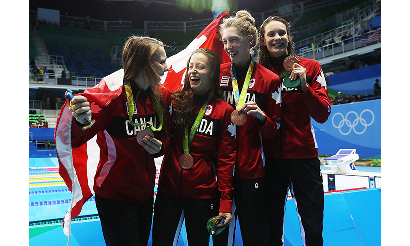 Making Canada proud! Swimmers Taylor Ruck, Brittany McLean, Katerine Savard and Penny Oleksiak show off their bronze medals after a fantastic performance in the women's 4 x 200m freestyle relay on day five of the games. 