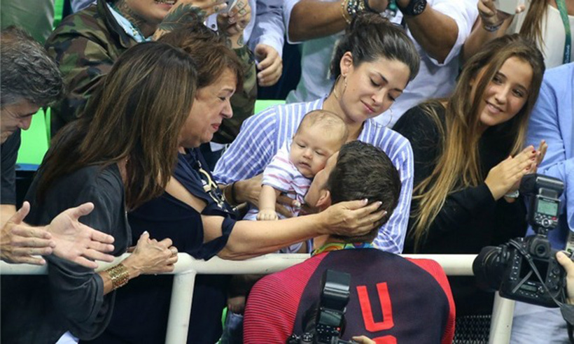 American swimmer Michael Phelps celebrates his 20th gold medal win with his three-month-old son Boomer. 