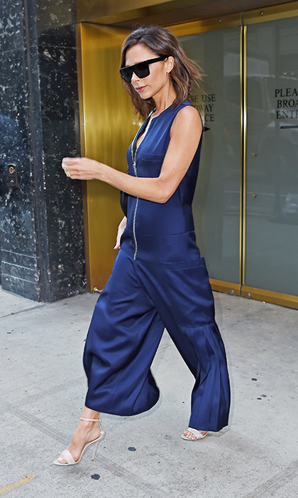 Victoria Beckham stepped out in a high-shine cobalt jumpsuit from her eponymous line in New York, lending the sporty look a chic edge with strappy nude sandals.