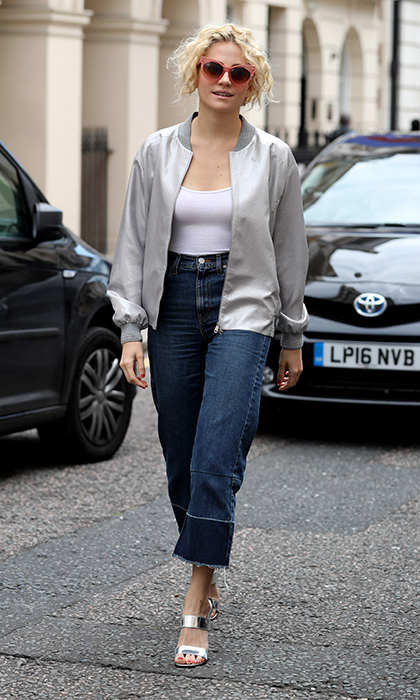 English songwriter Pixie Lott rocked a metallic Antipodium varsity jacket with cropped jeans and matching heels in London.